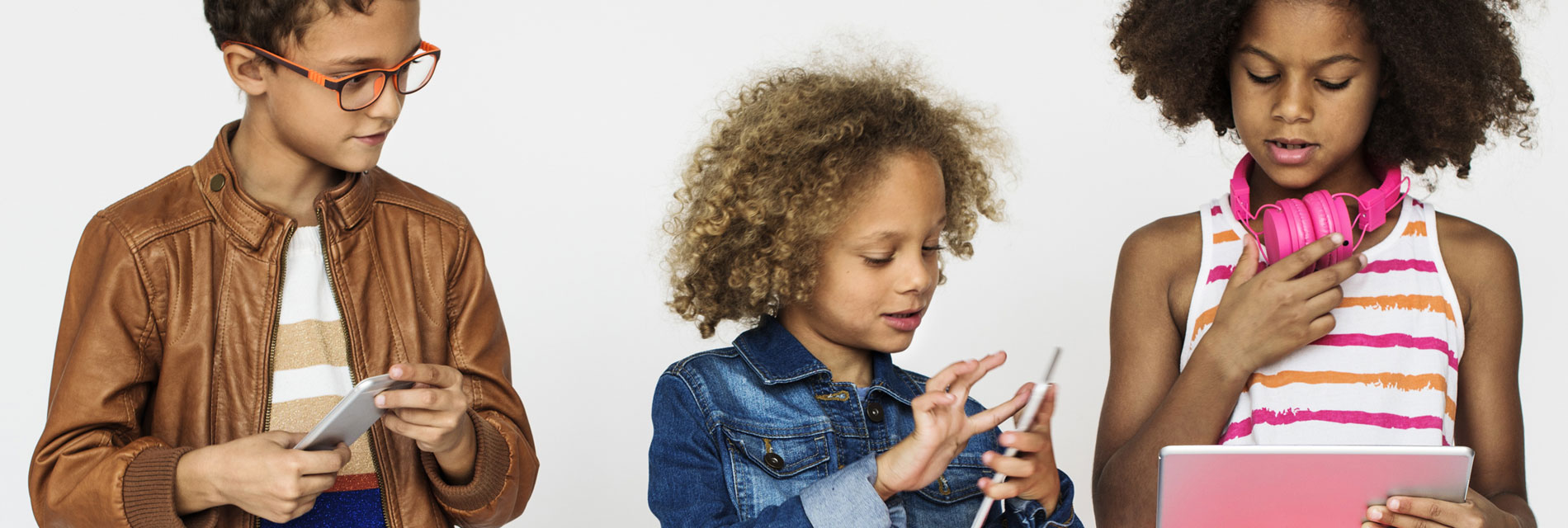 Children playng on tablets / phones